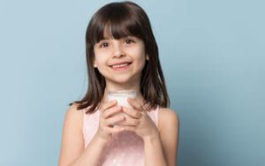 Child Drinking Milk With Clean Smile